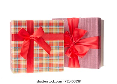 Gift boxes with red ribbons for Valentines day or Christmas, new year. Isolated on white