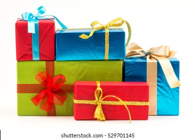 Gift boxes with ribbons and christmas decor isolated on white background. Happy birthday colorful gifts