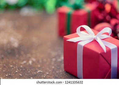 Gift boxes with a white bow against a background bokeh of twinkling  Luxury New Year gift. Christmas gift. Christmas background with gift box Christmastime celebration