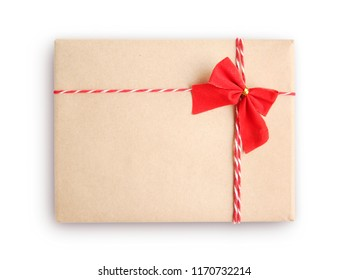 Gift box,mail parcel, post delivery wrapped with kraft paper and red twine rope isolated on white background. Craft present for christmas holiday.