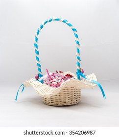 The gift by wicker basket with white background