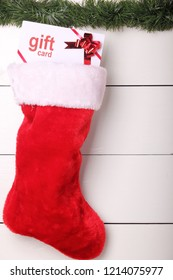 Gift certificate in a red and white Christmas stocking