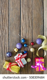 Gift and christmas ball decoration for merry christmas and happy new year on wooden table / Image Select focus and Space for text