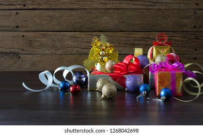 Gift and color ball decoration for happy new year on wooden table / Image Style blurred and select focus