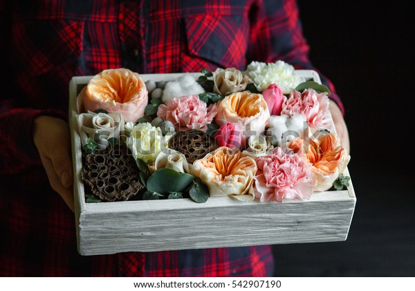 Gift composition with flowers in a wooden box
