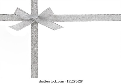 Gift concept - Silver bow and ribbon isolated on a white background