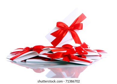 Gift envelopes with awesome red bows isolated on white