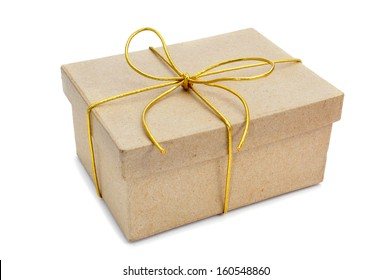 a gift with a golden ribbon on a white background