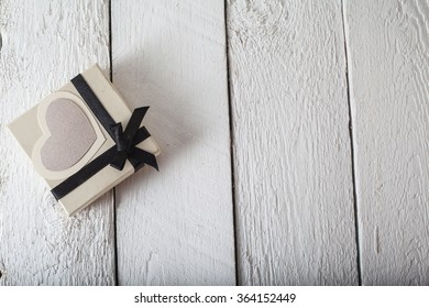 a gift from the heart of paper with love. bright picture on a wooden background