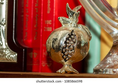 A gift for home to wish prosperity and good luck. A silver pomegranate.