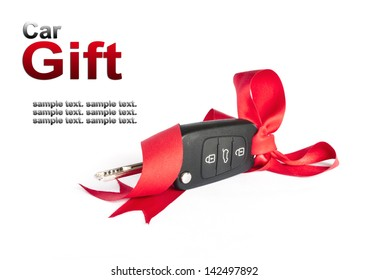 Gift key concept with red Bow on a white background.