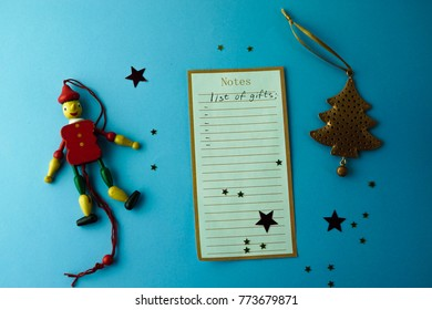 gift list wish Christmas composition on blue background flat lay
