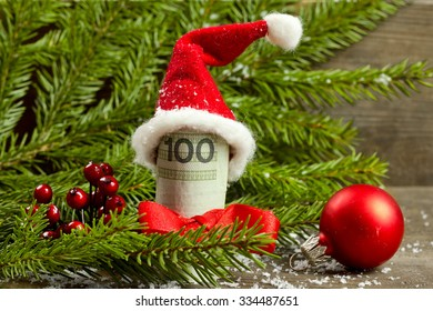 Gift money with red ribbon and Santa cap