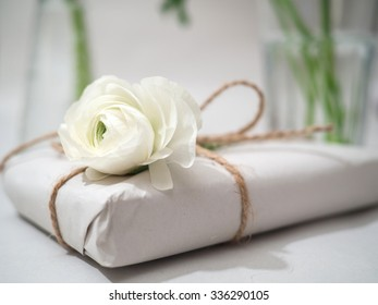 Gift with natural packaging and a white rose