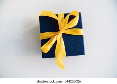 a gift on a green background