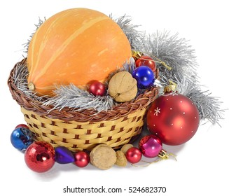 gift on new year pumpkin, Christmas tree decorations, tinsel, walnuts, almonds, and colored glass balls in the basket isolated on white background
