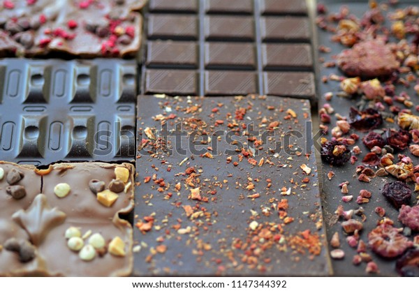 A gift pack of artisan handmade chocolate. Chocolate bars with dried fruit, top view.