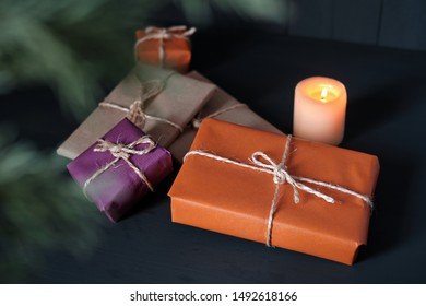 Gift packages in kraft paper and a candle