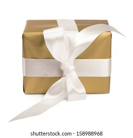 gift packed into golden box with White Ribbon isolated