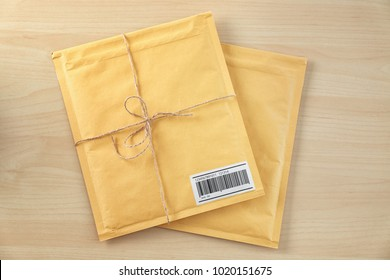 Gift padded envelopes on wooden table