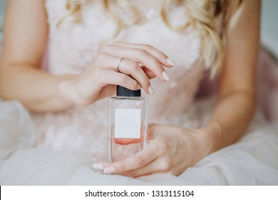 gift perfume in a bottle in female hands for inscription free