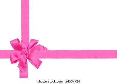 Gift pink ribbon and bow isolated on white.