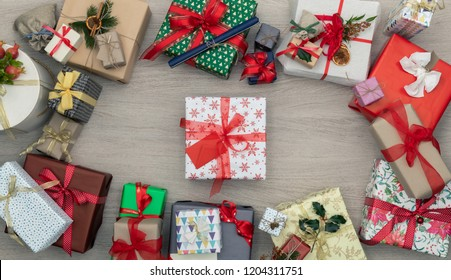 Gift present box in vertical top view wooden table full of christmas or birthday gifts presents.Xmas winter holiday season party social media card background,portrait story