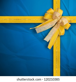 Gift and present wrapping box with Gold ribbon and cyan paper