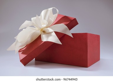 Gift red box tied with white bow-knot on the cover.