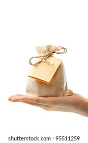 Gift sack with card in female hand