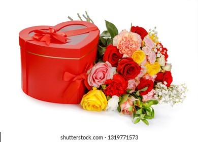 gift in the shape of a heart and a bouquet of beautiful roses.