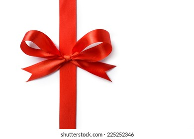 Gift silk bow of red ribbon isolated on white background