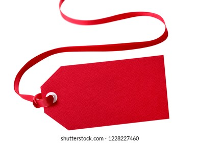 Gift tag red ribbon isolated on white close up