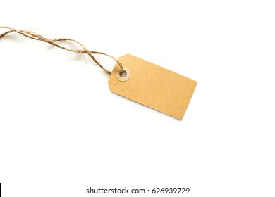 Gift tags made from recycled paper with string on white background