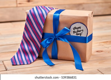 Gift, tie and Father's card. Striped tie on present box. Best quality gifts for dads.