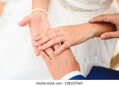 Gift for valentines, engagement and wedding rings in the hands of the bride and groom.