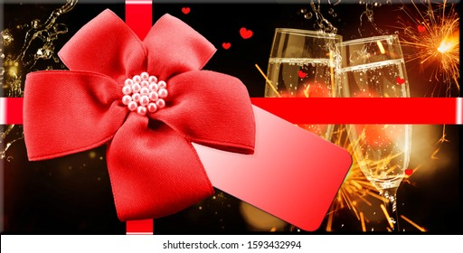 Gift voucher with a bow in front sparkling wine and fireworks