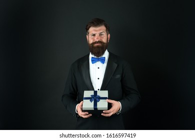 Gift whatever you want. Businessman with gift dark background. Bearded man hold gift box. Boxing day. Gift from boss. Award and benefit. Bonus and reward. Giveaway. Solution for any occasion.