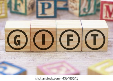 Gift word written on wood cube