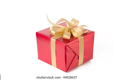 Gift wrapped with golden bow, white background