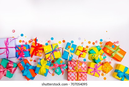 Gift wrapped in paper. Small gifts are packed in colored paper. Colored ribbons. Gift wrapping. View from above.