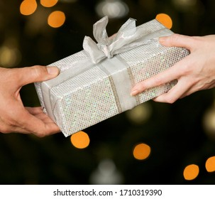 A gift wrapped present being exchanged