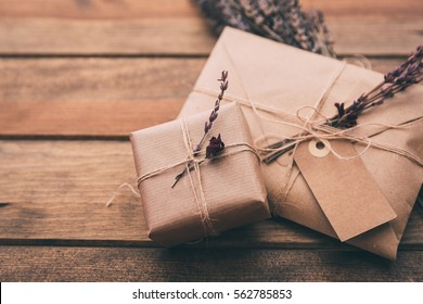 Gift wrapping composition. homemade wrapped  present boxes, decoration and tools on wooden background. above view, flat lay