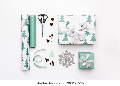 Gift wrapping composition. Nordic christmas gifts isolated on white background. Turquoise colored wrapped xmas boxes.