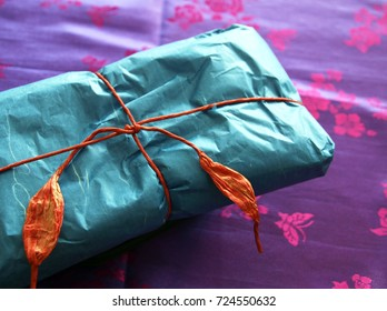 Gift wrapping with paper and paper ribbon in Korean traditional style (shallow depth of focus)