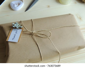 Gift wrapping. Parcel on wooden background. Small business.
