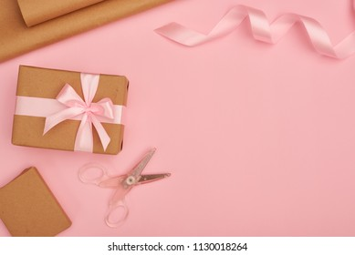 Gift wrapping set on pink flatlay