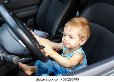 Gifted small kid drives real car