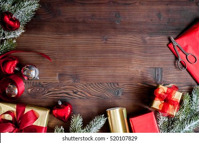 gifts boxes with fir branches on wooden background top view