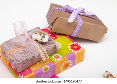 gifts in boxes on a white background place copy top view golden ribbon with bow wrapped in brown paper purple ribbon braid cute bears for decoration bright colorful